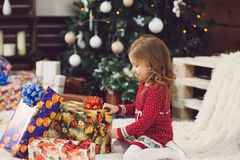 Girl Touching Present Box Royalty Free Stock Image