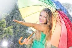 Girl touching raindrops Royalty Free Stock Photo