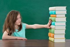 Girl Touching Stack Of Books Royalty Free Stock Photos