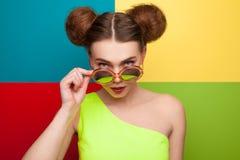 Girl touching sunglasses looking at camera royalty free stock photos