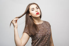 Girl touching tips of  her long hair Royalty Free Stock Image