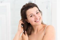 Girl touching wet hair Stock Image