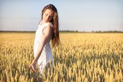 Girl touching wheat. Royalty Free Stock Photos
