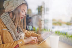 Girl with touchpad Royalty Free Stock Image