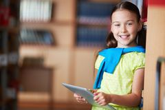 Girl with touchpad Stock Images