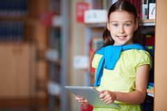 Girl with touchpad Royalty Free Stock Photos