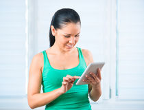 Girl with the TouchPad Royalty Free Stock Images