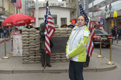 Girl tourist on background checkpoint Charlie Stock Image
