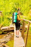 Girl tourist with a backpack in the woods Stock Image