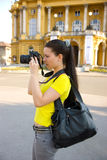 Girl tourist with camera Stock Images