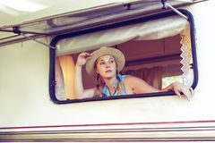 Girl tourist in a camper van.