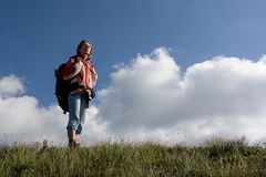 Girl tourist exploring the mountains. Royalty Free Stock Photos