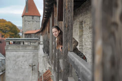Girl tourist on the fortress wall Royalty Free Stock Image