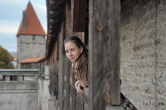 Girl tourist on the fortress wall Stock Photography