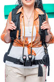 Girl tourist holds the straps of a large backpack Stock Image
