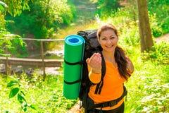 Girl tourist invites a hike Stock Image