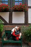 Girl tourist kissing Maltese bichon dog in Germany. Girl tourist kissing Maltese bichon puppy dog in Germany Stock Images