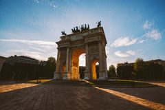 Girl tourist looking atArch of Peace in Sempione Park, Milan, Lombardy, Italy. Arco della Pace aka Porta Sempione in Milan, Italy.  Royalty Free Stock Images