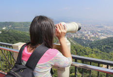Girl-tourist looks at the city Royalty Free Stock Photography