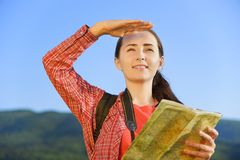 Girl tourist looks into the distance Royalty Free Stock Photo
