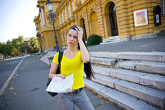 Girl tourist with map Royalty Free Stock Photography