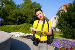 Girl tourist with map and camera Stock Image