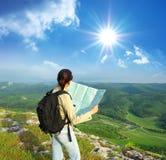 Girl tourist in mountain stock photo