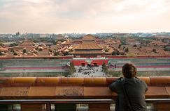 A girl Tourist Observing Forbidden City stock photography