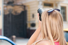 Girl tourist photographs architecture of the city Stock Photo