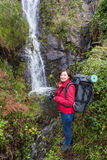 Girl tourist photographs waterfall. Portugal . Stock Photography