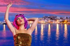 Girl tourist pink wig in Ibiza nightlife at sunset Stock Photo