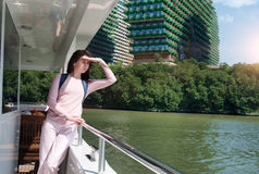 Girl tourist ship sails on the river Stock Photos