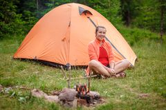 Girl tourist sitting near tent Royalty Free Stock Photography