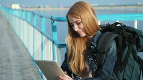 Girl tourist sitting with tablet stock video footage