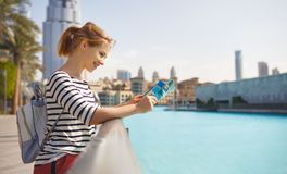Girl tourist travels with map through streets of  city. Girl tourist travels with a map through streets of city Stock Photos