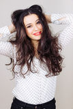Girl with tousled hair. Funny and cute girl with polka dots shirt holding her tousled hair Royalty Free Stock Photo