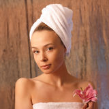 Girl in a towel. The fine girl in a towel on a head with a flower Royalty Free Stock Photo
