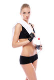 Girl with towel and bottle of water Royalty Free Stock Photos