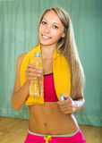 Girl with towel and bottle of water Stock Photo