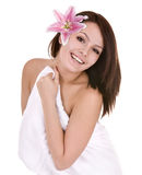 Girl with towel and flower in beautician spa. Royalty Free Stock Images