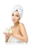 Girl with towel on head hands lily Stock Photos