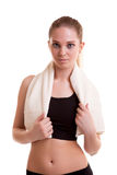 Girl with towel on shoulder isolated over white background Stock Image
