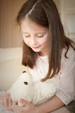 Girl with a toy Stock Images