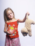 Girl with toy. Little girl think about new toy royalty free stock photo