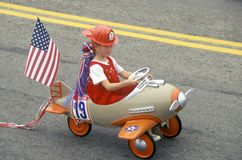 Girl in Toy Airplane in July 4th Parade, Cayucos, California Stock Photo
