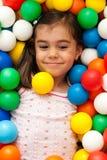 Girl in toy balls Stock Photos