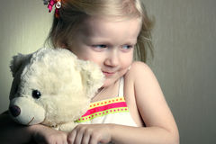 Girl with toy bear Stock Images