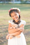 Girl with toy bear stock photo