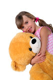 Girl with toy bear Stock Photos