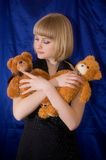 Girl and toy bears Stock Images